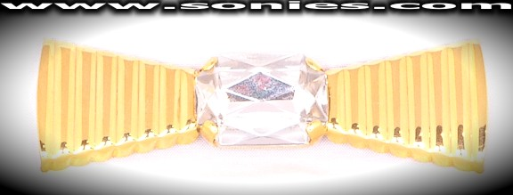 Truly elegant Chryseïs bow brooch with large clear crystal