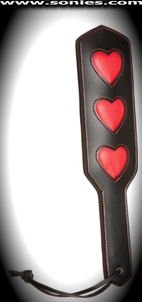 Queen of Hearts faux leather paddle with red hearts impression