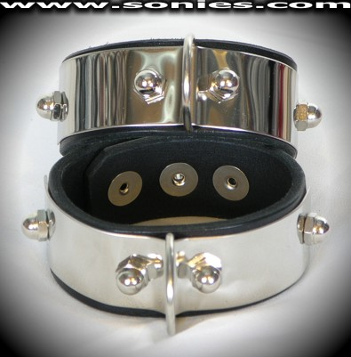 Pair of stainless steel with leather wristband and D-ring